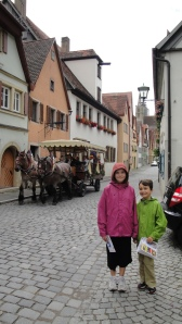 The picturesque town of Rothenburg with a picturesque horse-drawn carriage.